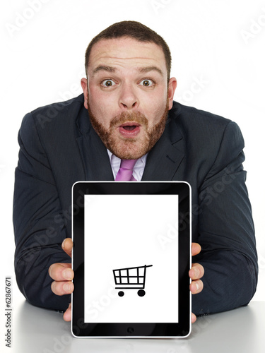 Business man presenting tablet pc with copyspace