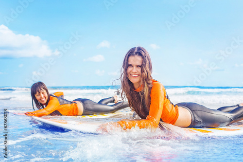 Surfer girls in Bali
