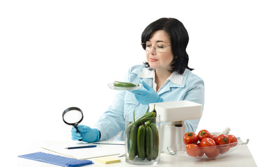 Phytosanitary technician stares at the cucumber