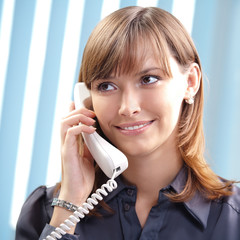 Young woman with phone, at office
