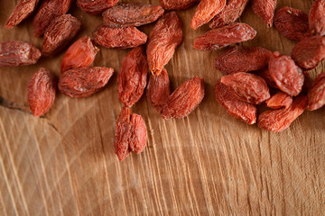 Dried goji berries on wood table