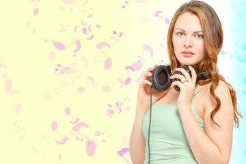Conceptual young woman holds headphones
