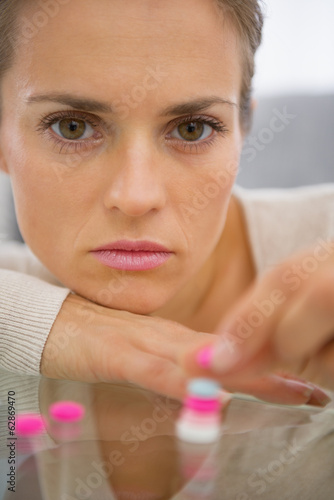 Portrait of young woman with pills