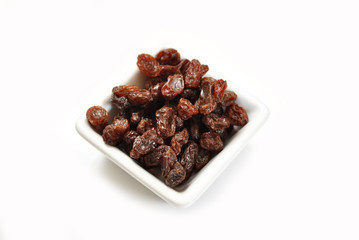 A Healthy Treat of Dried Raisins in a Square Bowl