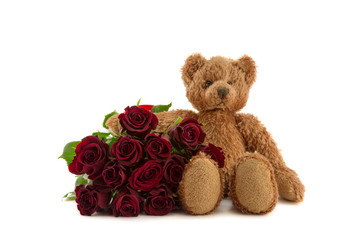 Twelve red roses and teddy.