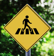 Yellow traffic label with street crossing pictogram