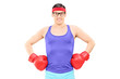Young athlete with boxing gloves posing