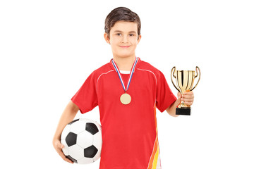Football player holding a golden cup