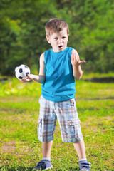cute boy with football ball