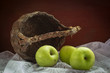 Still life green apples with old basket.