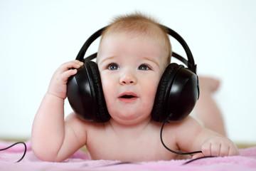 baby listening to music through headphones