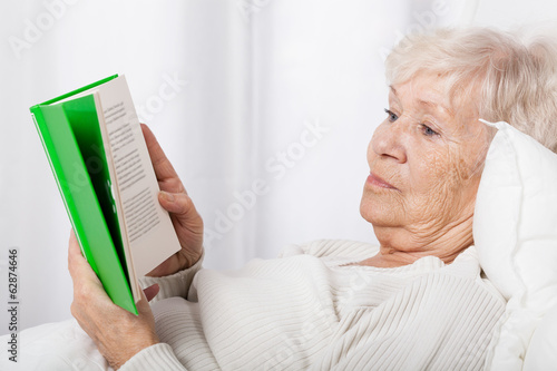 Elderly lady reading book