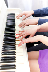 Сlose up view of hands playing piano