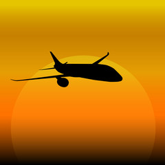 plane on a sunset background