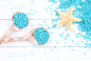 Sea salt crystals in wooden spoons with starfish