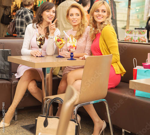 Relaxed women eating tasty ice cream
