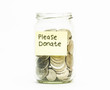 Isolated coins in jar with please donate label