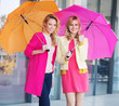 Blonde girls with colorful umbrellas