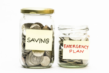 Coins in jar with emergency plan and emergency plan label