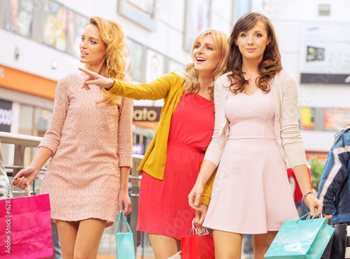 Happy girlfriends in the shopping mall