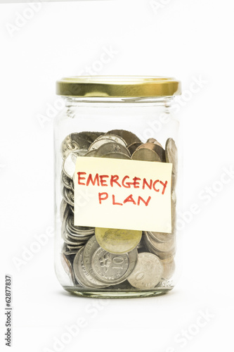 Isolated coins in jar with emergency plan label