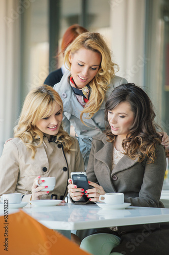 Group of the smiling women in the coffee shop