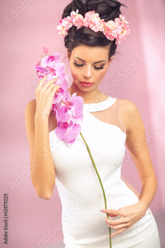 Sensual brunette girl with flower