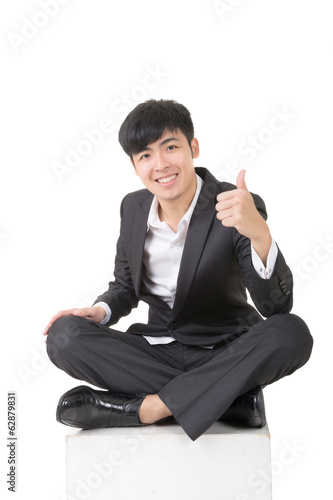 Asian businessman sit and give you an excellent sign