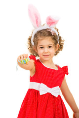 Small girl with bunny ears giving Easter egg