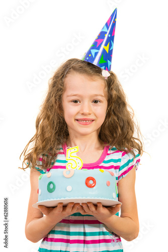 Cheerful girl holding birthday cake