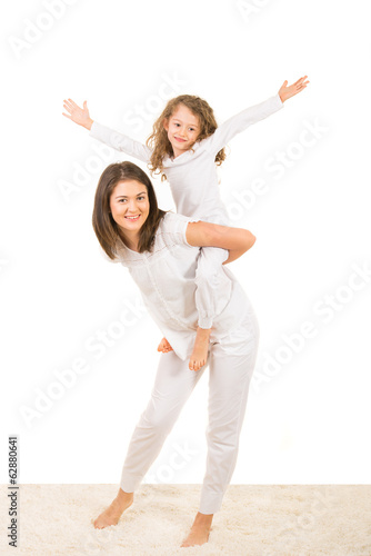 Mother and girl having fun home