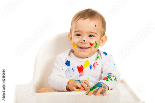 Laughing baby with colorful paints