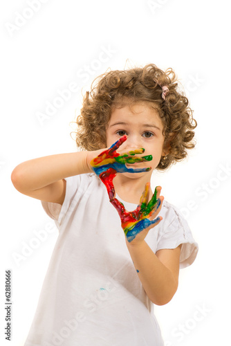 Little girl with colorful hands
