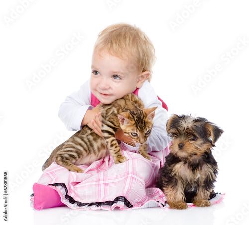 little girl with puppy hugging a kitten. isolated on white