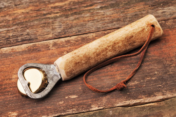 A wooden cork opener on the table