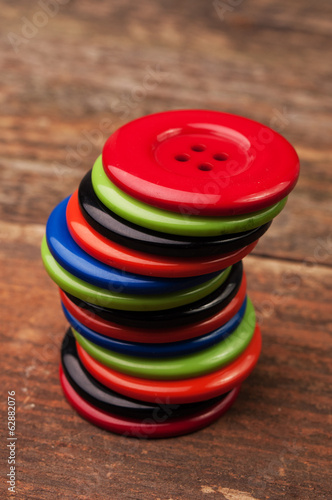 Stacked colorful plastic buttons on the table