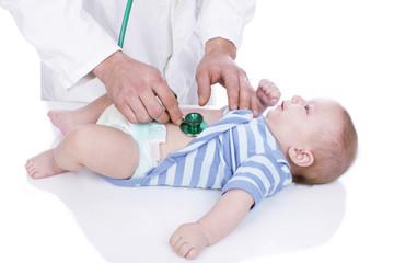 Doctor examins toddler
