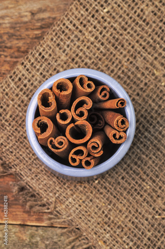 A jar of cinnamon sticks on the table