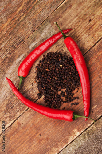 A triangle made of three peppers and allspice