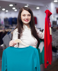 Brunette  woman choosing clothes at  store