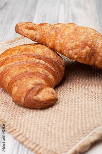 Two croissants on a linen cloth