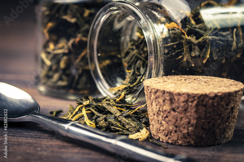 Some leaf tea in a jar with an open cork