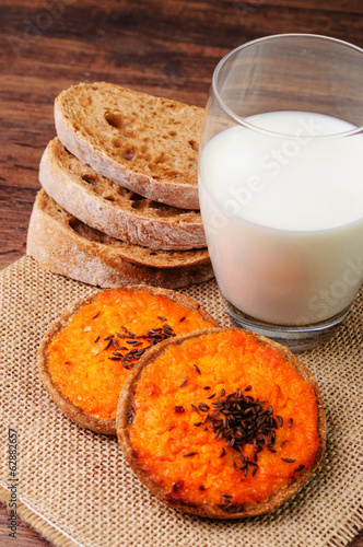 Carrot tartlets with a cup of milk