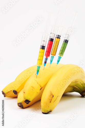 Some bananas with totally different color syringes