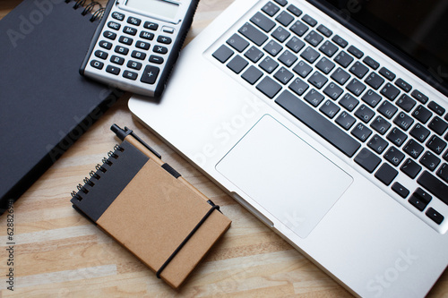 A laptop, a diary and a calculator