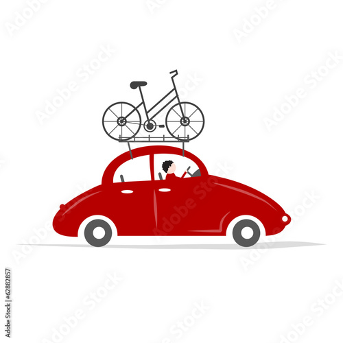 Man driving red car with bike on the roof rack