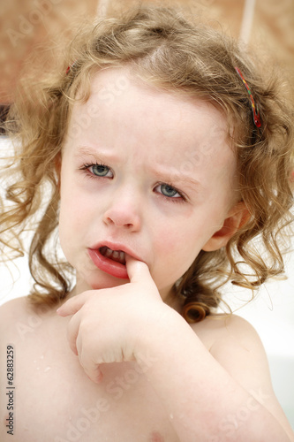 Little nasty child crying in the bath