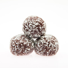 Stack of Chocolate balls with coconut flakes