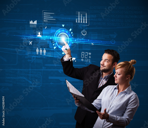 Young business couple touching future web technology buttons and