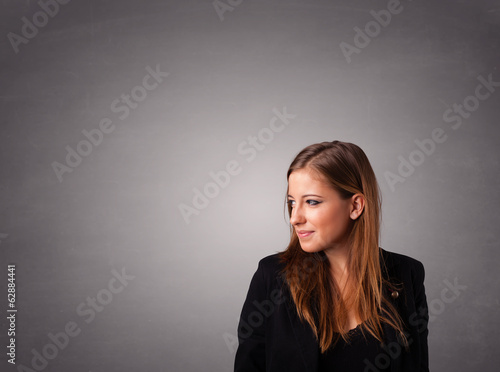 Young woman standing and thinking with copy space